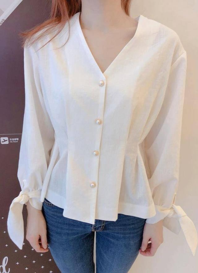白珍珠釦花袖襯衫